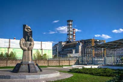 Chernobyl Monument and Reactor April 2012 Photo by Matt Shalvatis https://creativecommons.org/licenses/by-nc-sa/2.0/